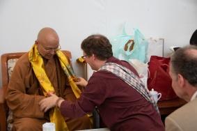 Professor Scherer handing a khatag to the Venerable Abbot Hsin Ting