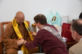 Professor Scherer handing a khatag to the Venerable Abbot Hsin Ting