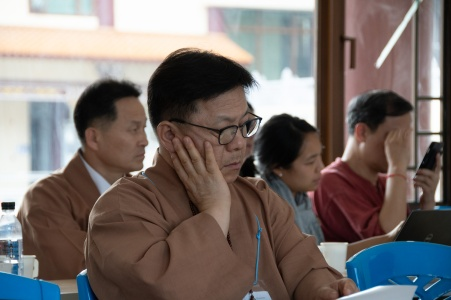 Master Beobkyung Kim listening intently to the other talks