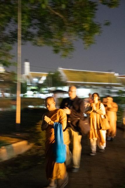 Night time meditative walk at the Wat Phra Sri Mahathat Woramahawihan